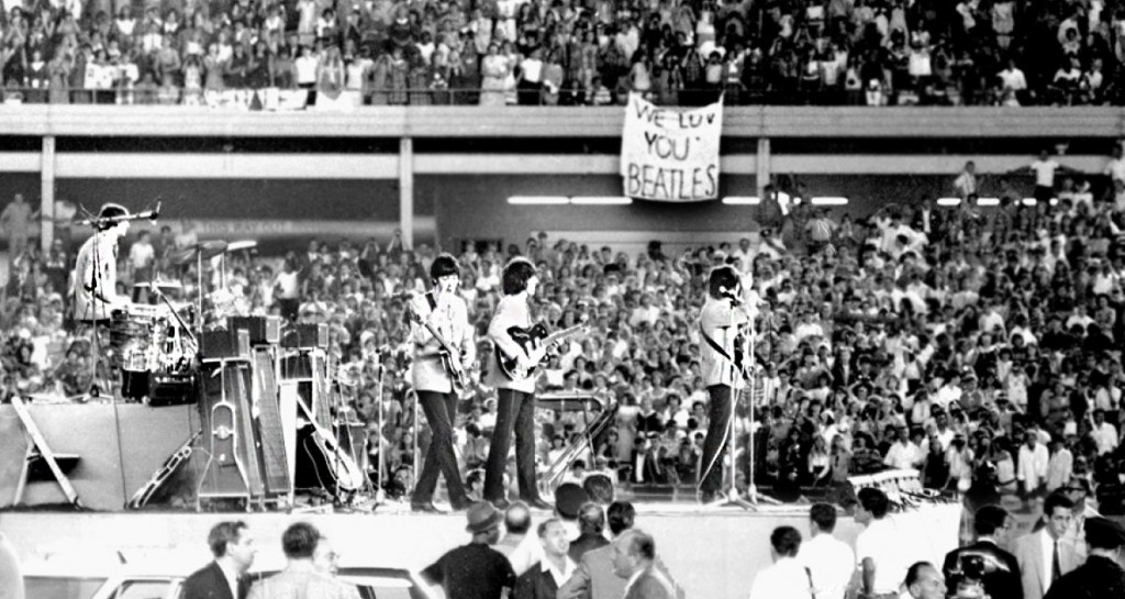 The Beatles performing at Shea Stadium