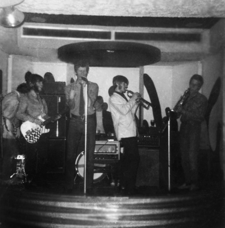 The last Jazzboard line-up at the New Cellar Club, South Shields. Left to right: Les Gofton (guitar) facing backwards, Peter Watson (bass), Bruce Lowes (vocals), George Muncaster (drums), Jim Hall (trumpet) & Roger Smith (tenor sax). Jimmy Hall (Hammond organ) partially hidden at rear right